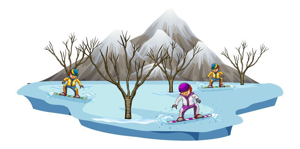 Tre uomini snowboard nel campo di neve