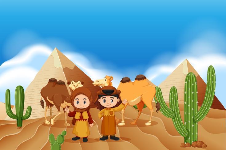 Barn och kameler i öknen