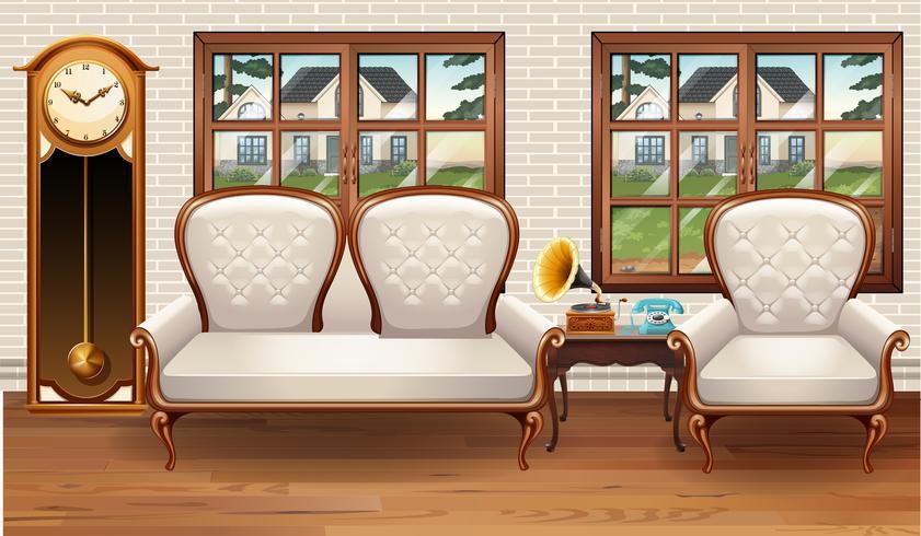 Raum mit weißem Sofa und Weinleseuhr