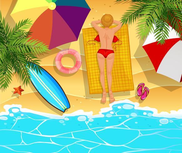 Mujer tomando el sol en la playa vector