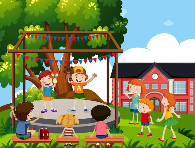 Los niños realizan un espectáculo de títeres en la escuela. vector