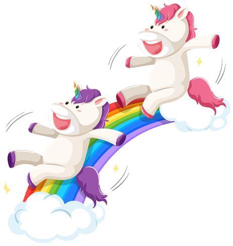 Felice unicorno sulla diapositiva arcobaleno