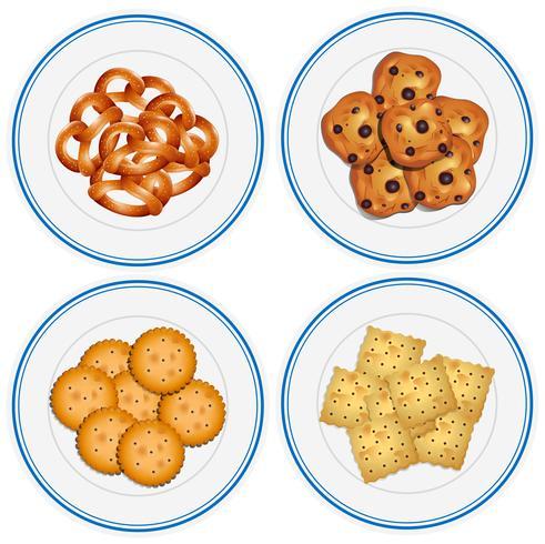 Quatre enfants sur des assiettes sur les assiettes