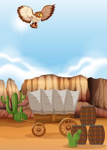 Uil die over de wagen in woestijn vliegt