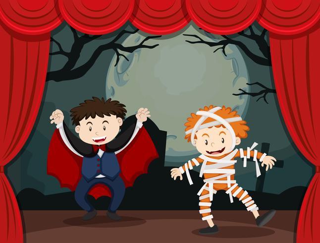 Dos niños disfrazados de halloween en el escenario vector
