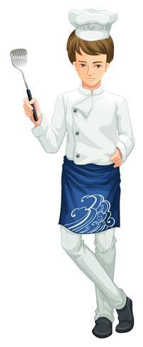 Un chef tenant un ustensile de cuisine
