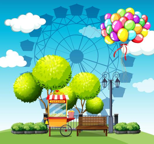 Park with popcorn vendor and balloons