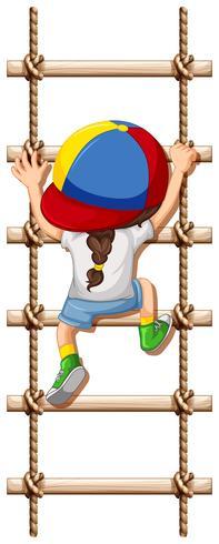 En baksida av tjejen klättring rep