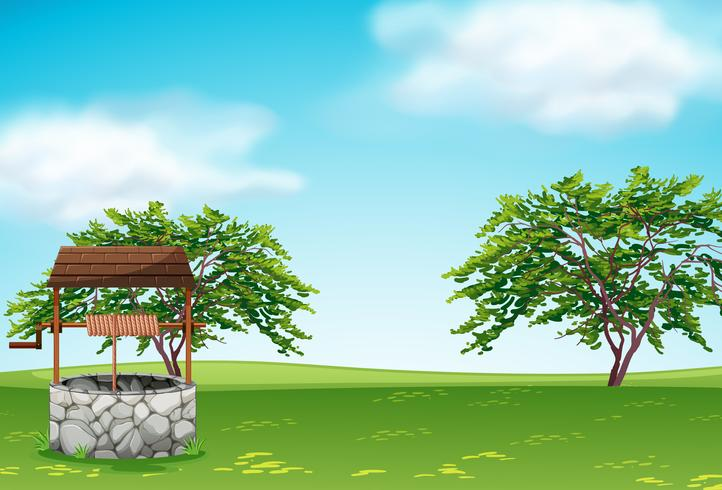 A well in the green landscape vector