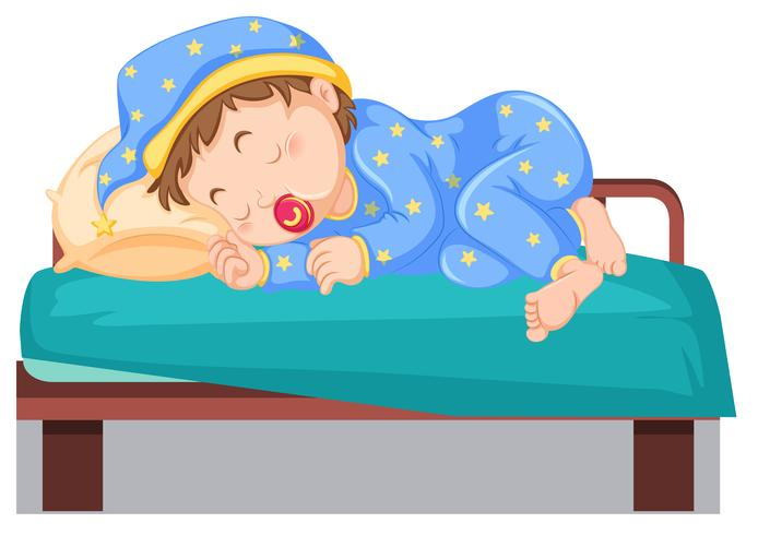Young child sleeping on bed