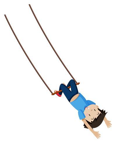 Een jongen op trapeze swing