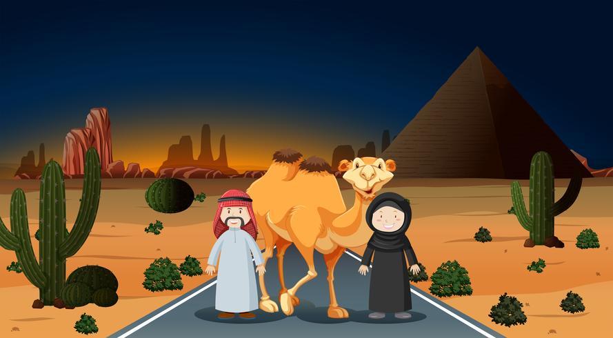 Arabisch paar met kameel op de woestijn