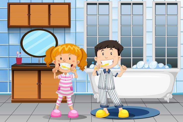 Niños cepillando los dientes en el baño