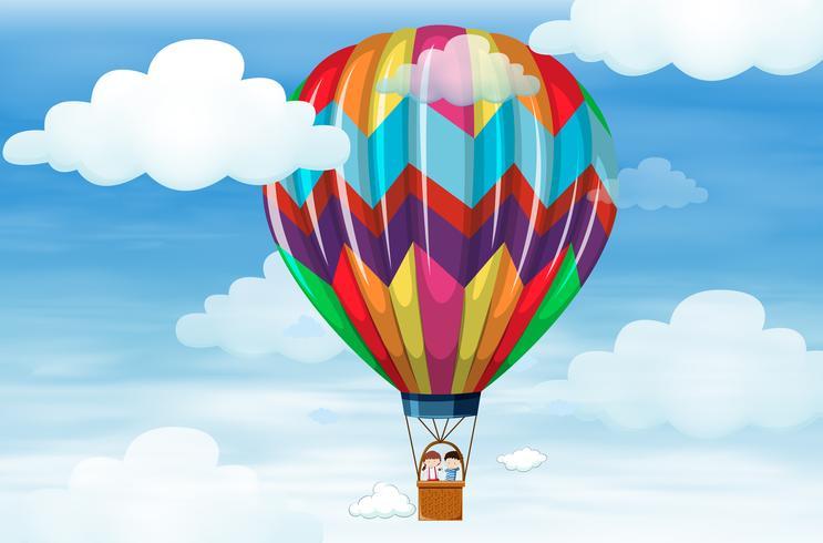 Niños montando en globo grande