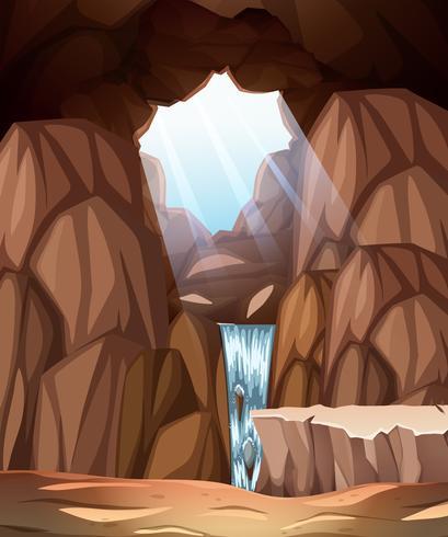 Scène de caverne avec puits de lumière et cascade vecteur