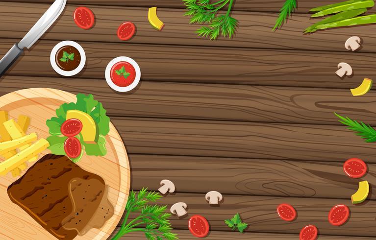 Bistecca e verdure sul bordo di legno