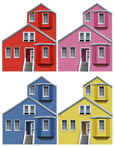 Houten huis in vier kleuren