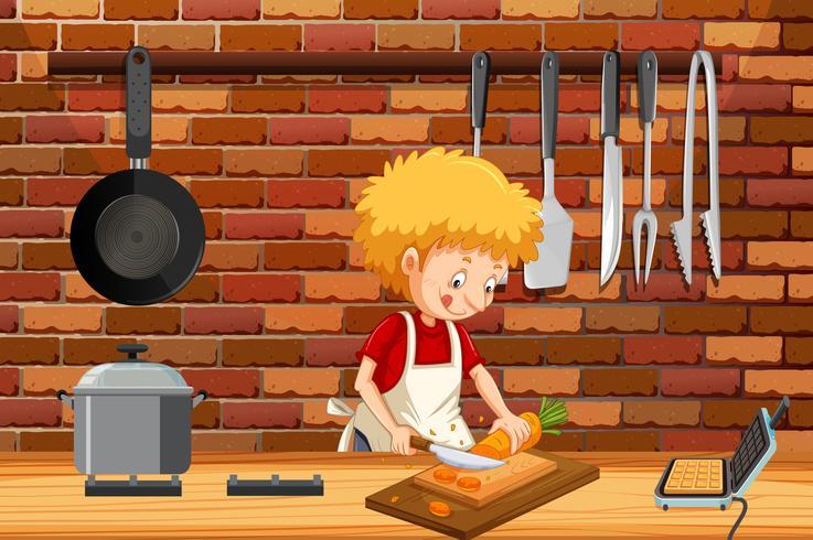 Un giovane uomo che cucina in cucina