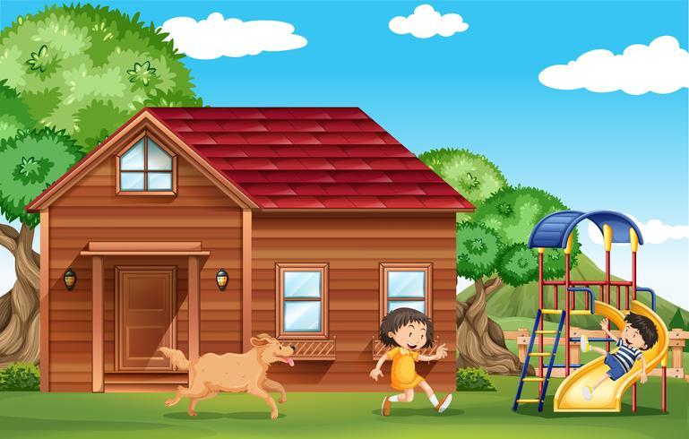 Barn som leker ute med hunden