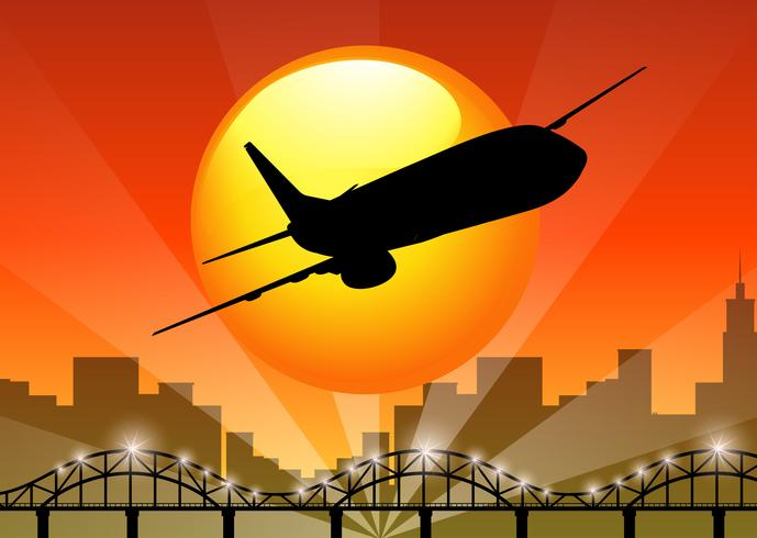 Vista de silhueta de avião sobrevoando a cidade