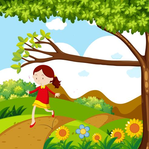 Menina pulando na estrada de terra