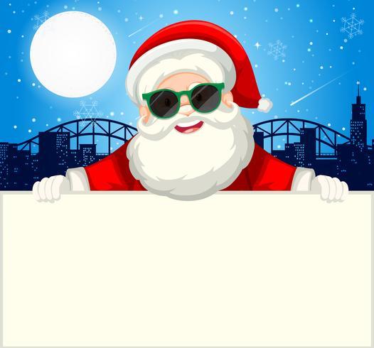 Santa holding plain paper concept