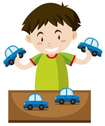 Garoto jogando com carros de brinquedo