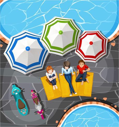 Piquenique de pessoas à beira da piscina