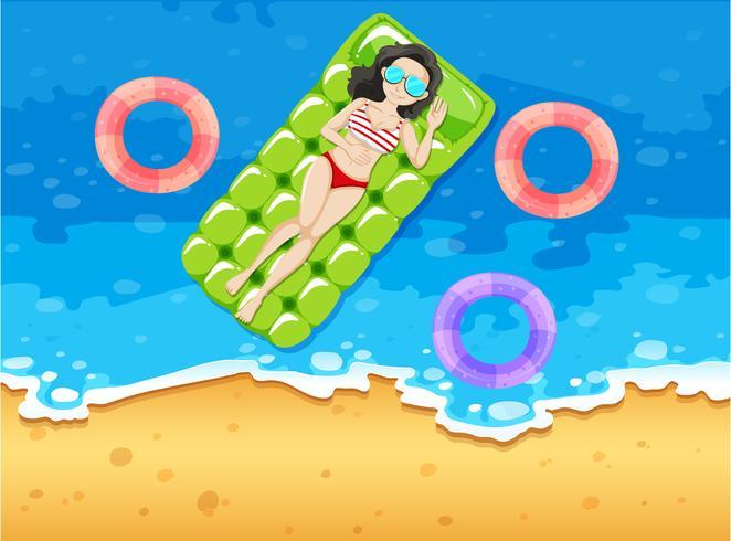 Woman sunbathing on floating raft vector