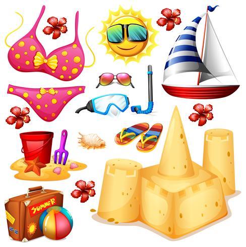 Set de verano con bikini y castillos de arena.
