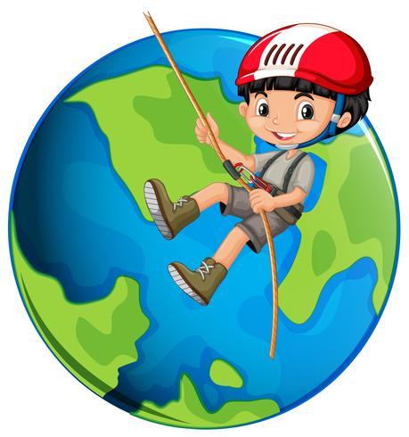 Un ragazzo corda arrampicata sulla terra