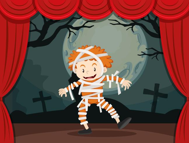 Pojke i zombie kostym på scenen