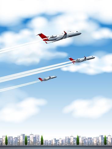 Drie vliegtuigen die over de stad vliegen