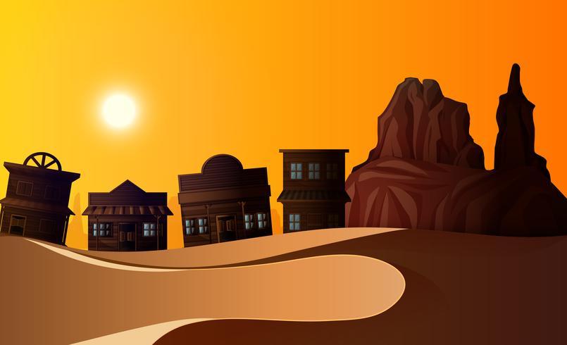 Scène de désert avec nombreux bâtiments au coucher du soleil