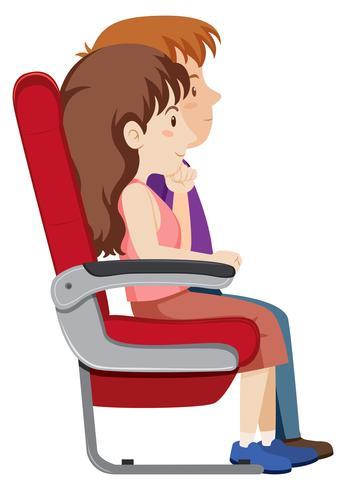 Coppia sul sedile dell'aereo
