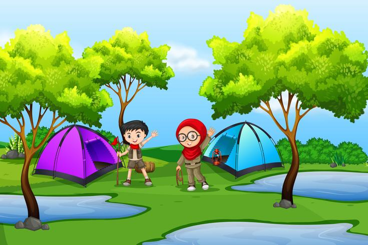 Boy and girl scout camping in nature