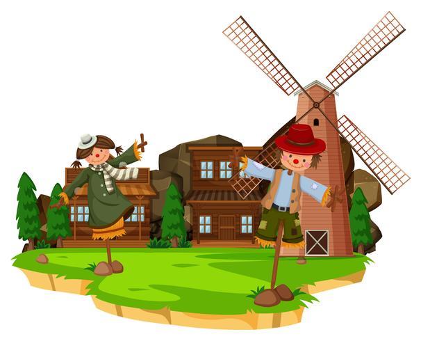 Scène de ferme occidentale avec épouvantails et moulin à vent