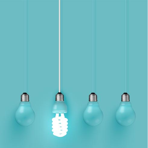 Energiespaarder lightbulb onder oude degenen, vectorillustratie