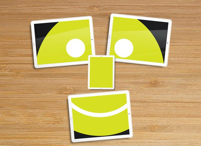 Desktop with tablets and an emoticon vector illustration