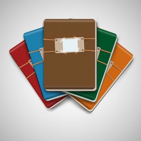 Fünf verschiedene bunte Notizbücher