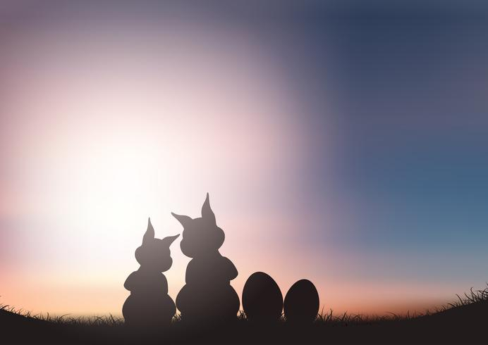 Silhouette of Easter bunnies against a sunset sky
