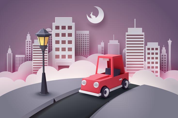 Papierkunst van rode auto opraken van de stad 's nachts
