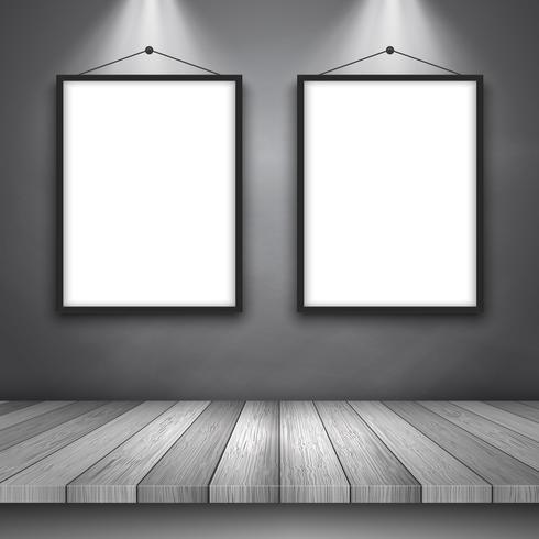 Fondo de exhibición con mesa de madera y marcos de cuadros en blanco.