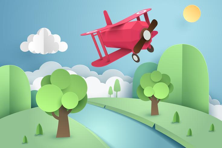 Papier d'art d'avion rose volant au-dessus de la forêt et de la rivière, origami et concept de voyage