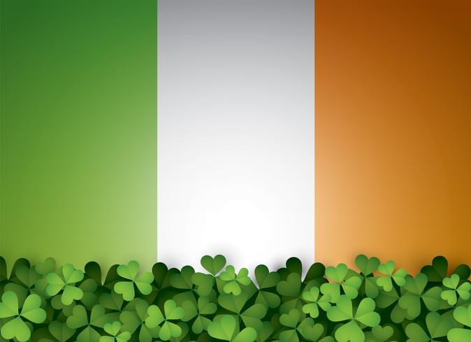 Hojas de trébol verde y bandera irlandesa. vector