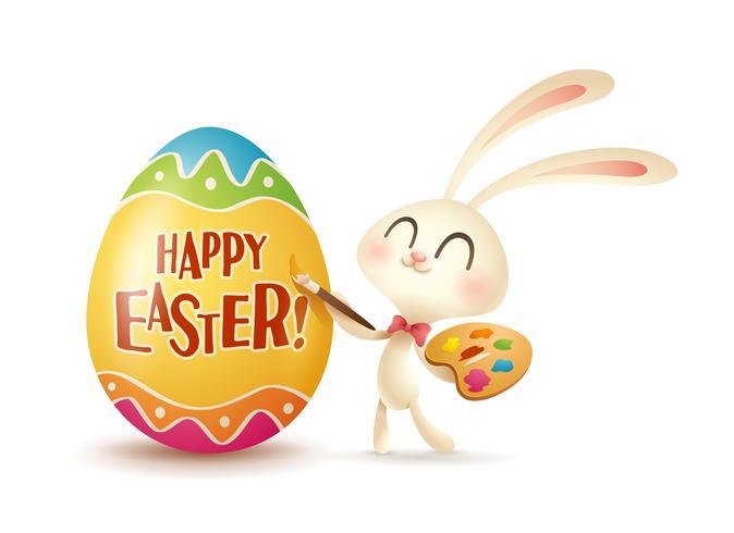 Conejito de Pascua pintando huevo.