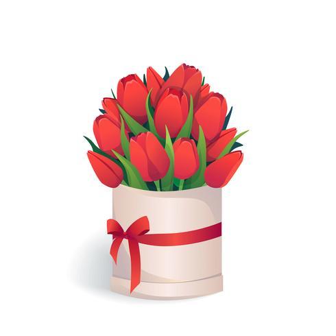 Boeket van rode tulpen in ronde hoedendoos.