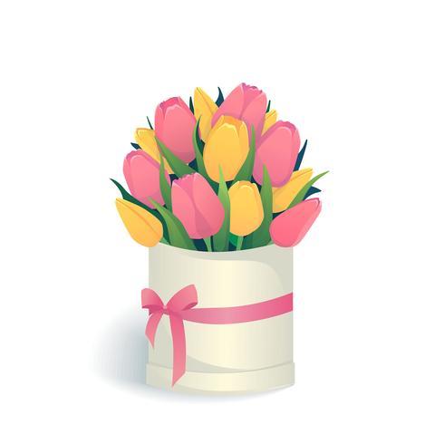 Bukett med rosa och gula tulpaner i rund hattlåda.