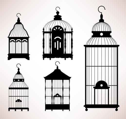 Silhouettes vintage de cage à oiseaux. vecteur