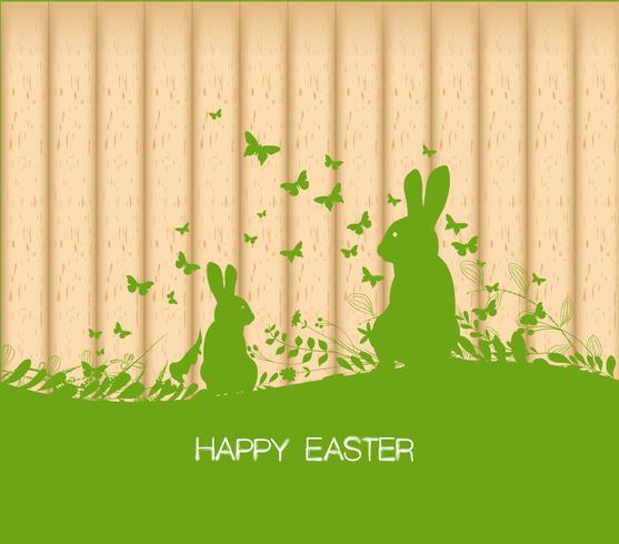 Biglietto di auguri di Pasqua con coniglio, regalo e luci sullo sfondo in legno
